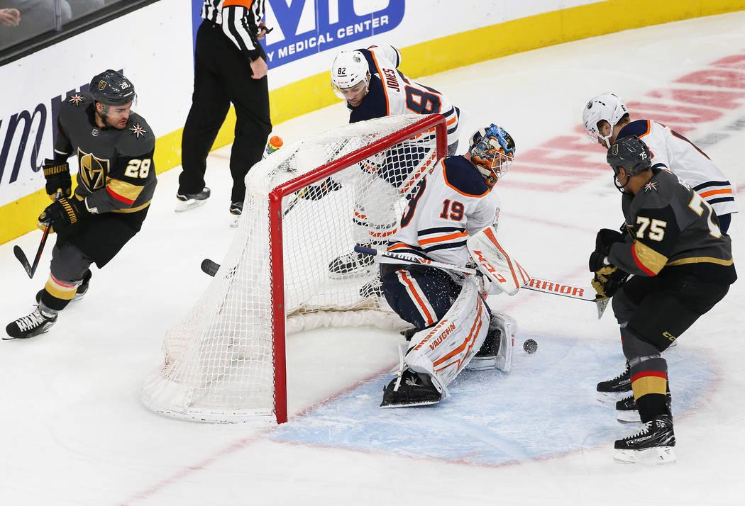 Edmonton Oilers goaltender Mikko Koskinen (19) makes a save against Vegas Golden Knights right ...