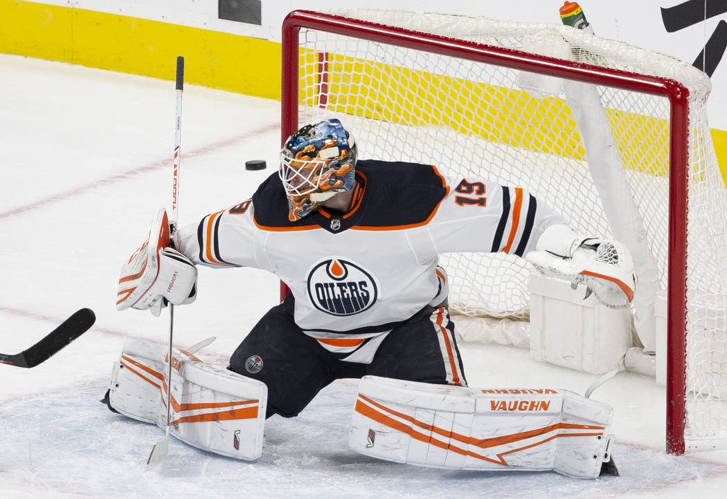 Edmonton Oilers goaltender Mikko Koskinen (19) makes a save in the second period of an NHL hock ...