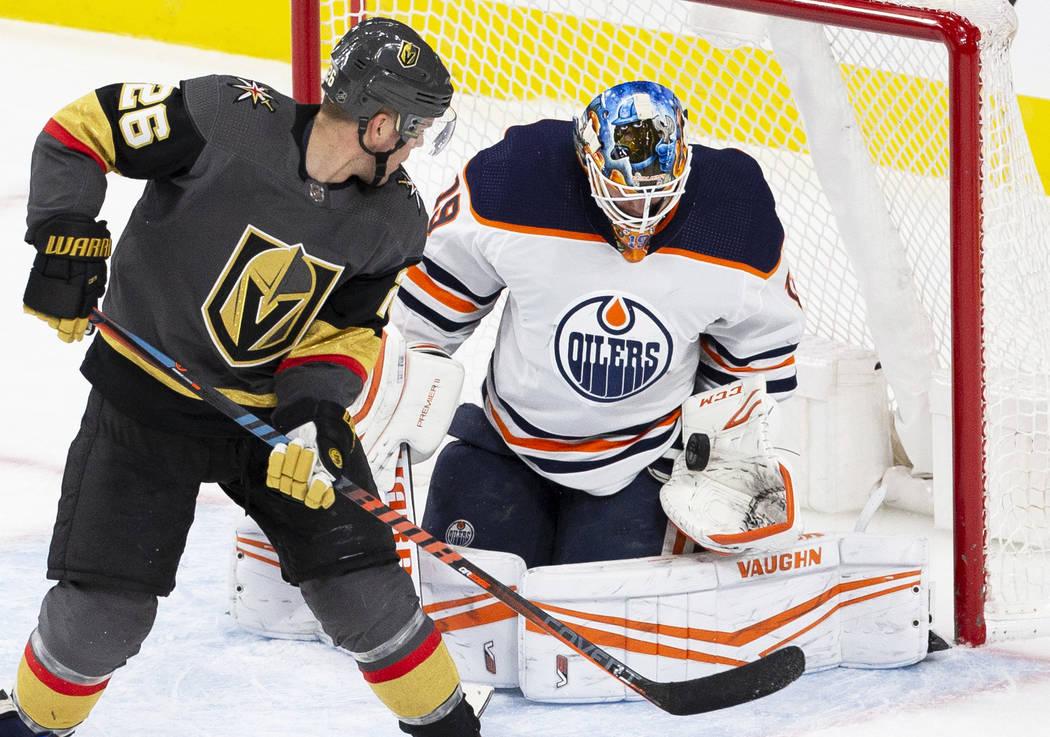 Edmonton Oilers goaltender Mikko Koskinen (19) makes a save against Vegas Golden Knights center ...