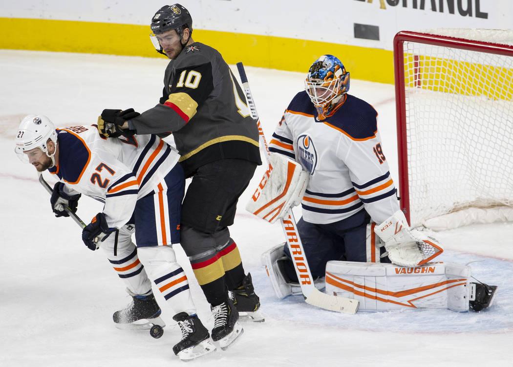 Edmonton Oilers defenseman Mike Green (27) blocks the shot of Vegas Golden Knights center Nicol ...