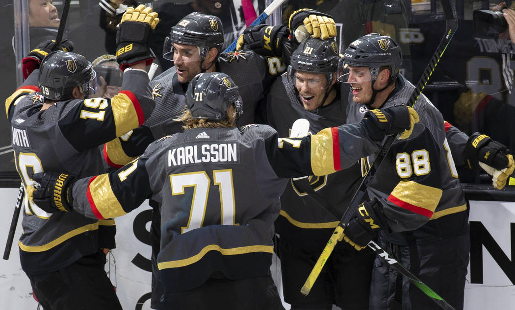 Vegas Golden Knights right wing Reilly Smith (19), Vegas Golden Knights center William Karlsson ...