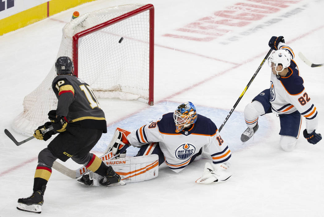 Edmonton Oilers goaltender Mikko Koskinen (19) makes a save against Golden Knights center Nicol ...