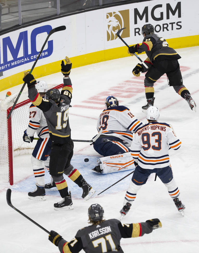 Vegas Golden Knights right wing Reilly Smith (19) and Vegas Golden Knights center William Karls ...