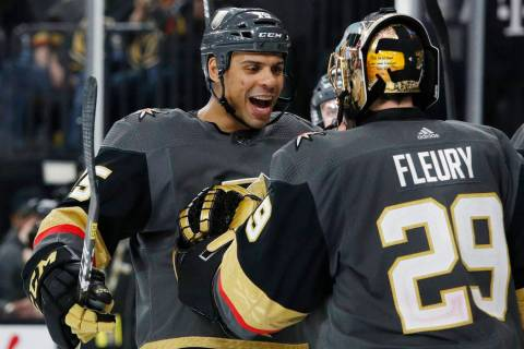 Vegas Golden Knights' Ryan Reaves, left, celebrates with goaltender Marc-Andre Fleury after def ...