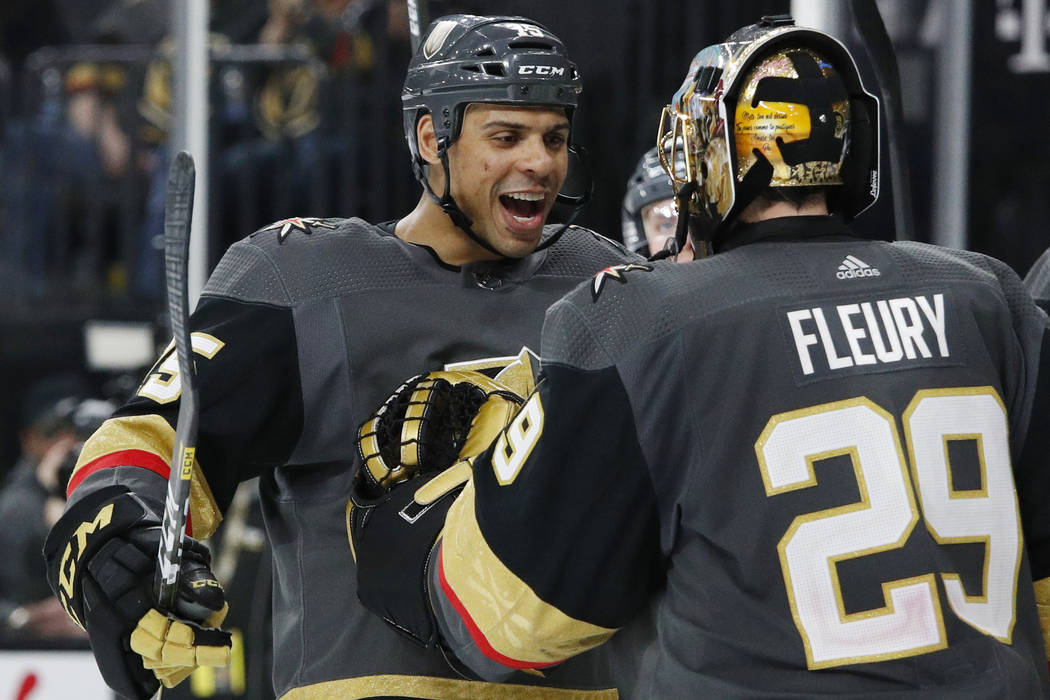 Vegas Golden Knights' Ryan Reaves, left, celebrates with goaltender Marc-Andre Fleury after def ...
