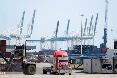 In this Friday, Feb. 14, 2020 photo, a truck leaves the docks at PortMiami in Miami. On Thursda ...