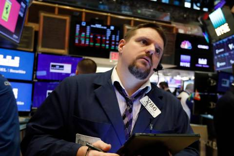 In a Feb. 24, 2020, file photo trader Michael Milano works on the floor of the New York Stock E ...