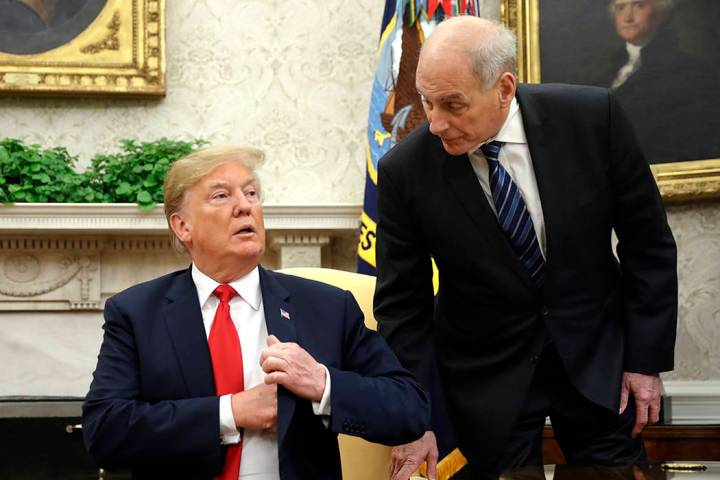 White House Chief of Staff John Kelly, right, leans in to talk with President Donald Trump duri ...