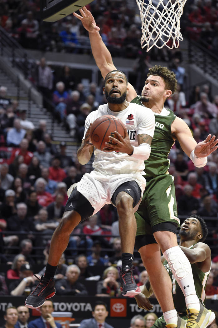 San Diego State guard KJ Feagin (10) drives to the basket past Colorado State guard David Roddy ...