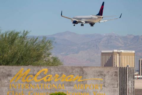 A Delta Airlines jetliner makes its approach to McCarran International Airport in Las Vegas on ...