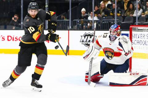 Golden Knights' Nicolas Roy (10) tries to redirect a shot against Florida Panthers goaltender S ...