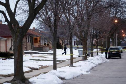 Police are seen outside of a house near Potomac and Courtland after a shooting at Molson Coors, ...