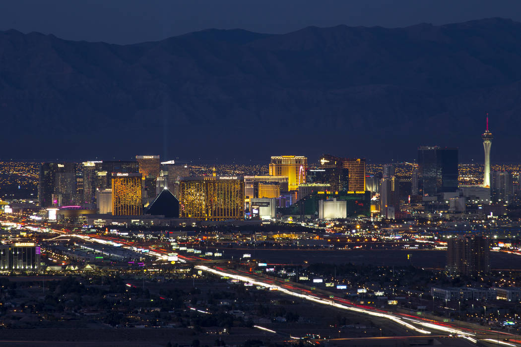 Traffic moves along Interstate 15 as Las Vegas casinos illuminate the city's skyline at dusk on ...