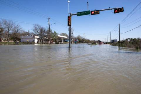 High water from a water main break floods Clinton Drive just east of the East Loop 610 on Thurs ...