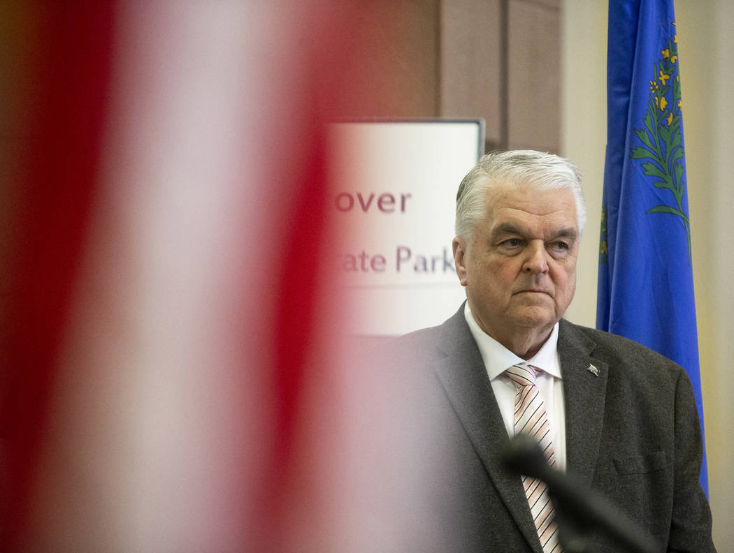 Gov. Steve Sisolak listens to a speaker during a press conference to update the public on the s ...
