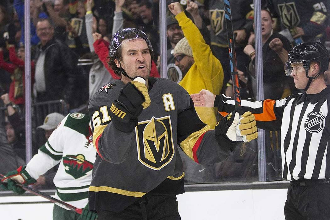 Vegas Golden Knights right wing Mark Stone (61) celebrates after teammate Chandler Stephenson ( ...