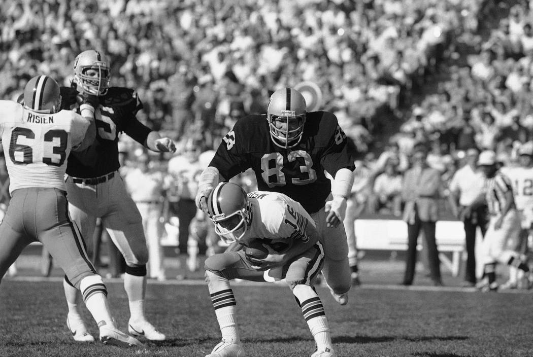 Los Angeles Raiders' Ted Hendricks, (83) proceeds to tackle Cleveland Browns' quarterback Paul ...
