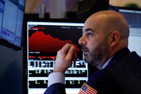 Trader Fred DeMarco works on the floor of the New York Stock Exchange, Friday, Feb. 28, 2020. G ...