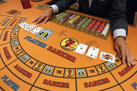 Cards are shown during a demonstration of play at an EZ Baccarat table at Palace Station on Wed ...