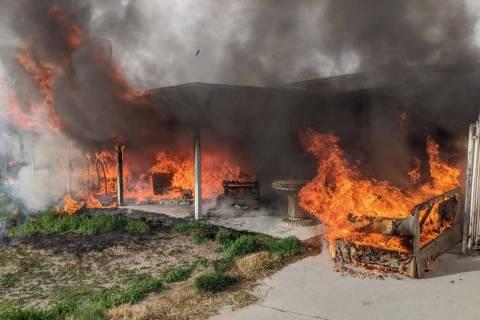 Firefighters battle a blaze at 1904 Leona Street on Friday, Feb. 28, 2020. (Las Vegas Fire Depa ...