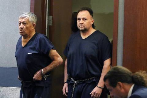 Former Las Vegas police officer Christopher Peto, 47, right, enters the courtroom during his co ...