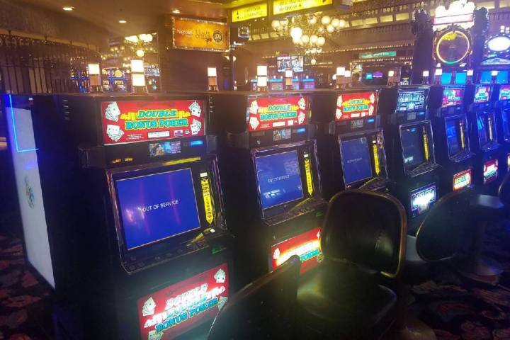 """Video poker machines at Four Queens show """"out of order"""" messages on Friday, Feb. 28, 2020. (Ric ..."""