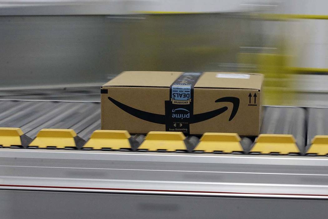 A Feb. 9, 2018, file photo shows a box for an Amazon prime customer moves through the new Amazo ...