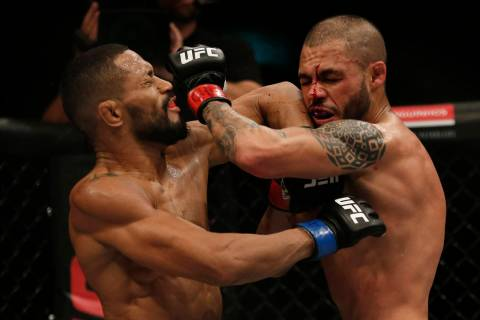 Deiveson Figueiredo, left, of Brazil, fights Marco Beltran of Mexico during their UFC bantamwei ...