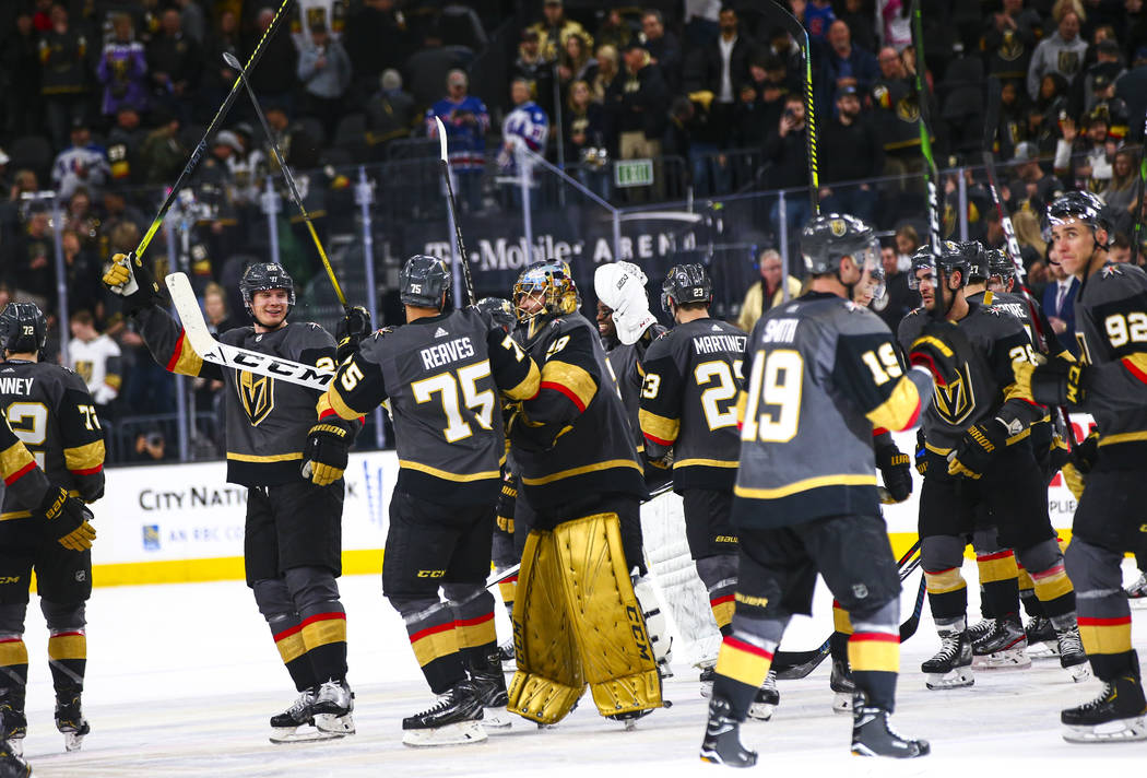 Golden Knights players celebrate after defeating the Florida Panthers in an NHL hockey game at ...