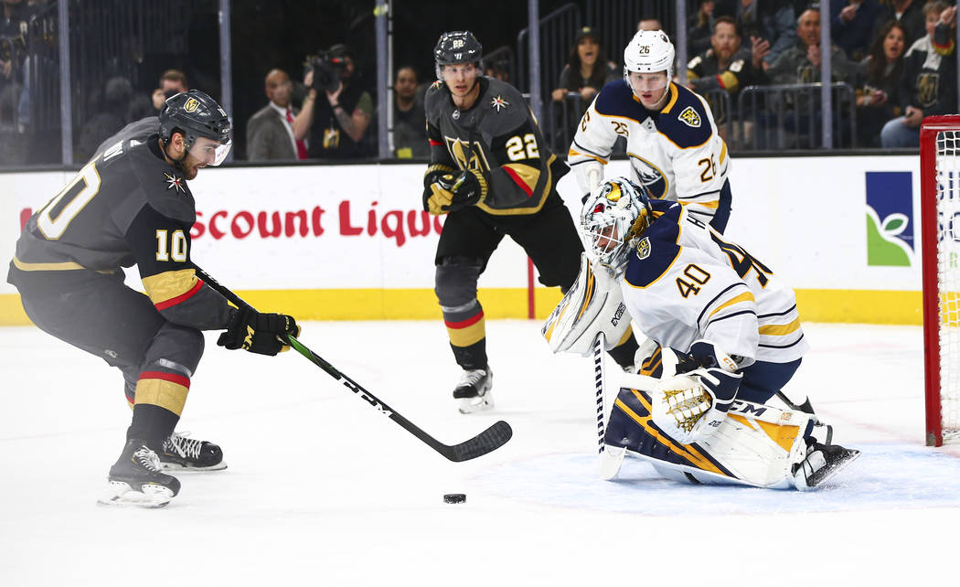 Golden Knights' Nic Roy (10) skates with the puck right before sending it past Buffalo Sabres g ...
