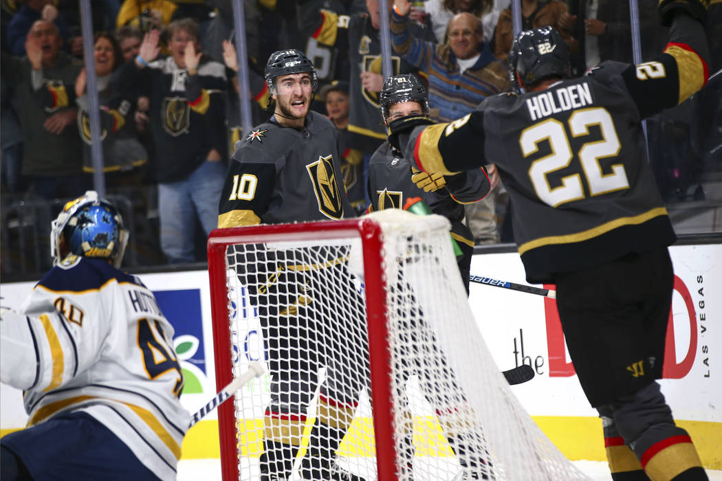 Golden Knights' Nic Roy (10) celebrates his goal against the Buffalo Sabres with teammates duri ...