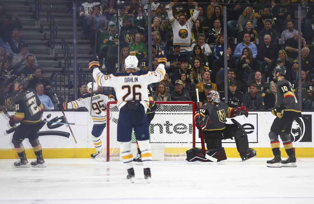 Buffalo Sabres players celebrate after scoring against Golden Knights goaltender Robin Lehner ( ...