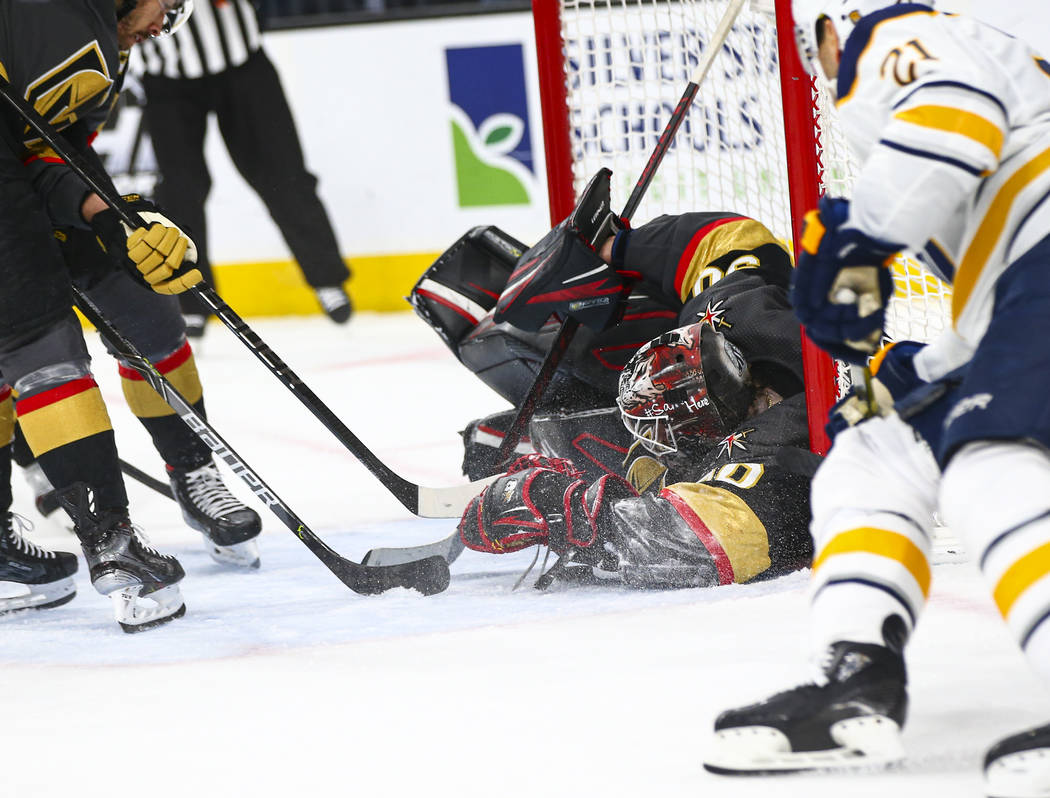 Golden Knights goaltender Robin Lehner (90) stops the puck during the second period of an NHL h ...