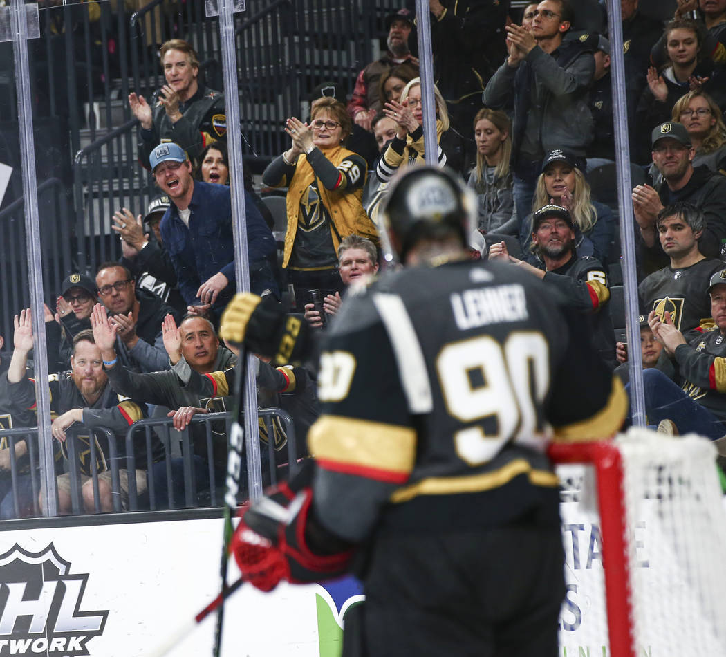 Golden Knights fans cheer after a stop by Golden Knights goaltender Robin Lehner (90) during th ...