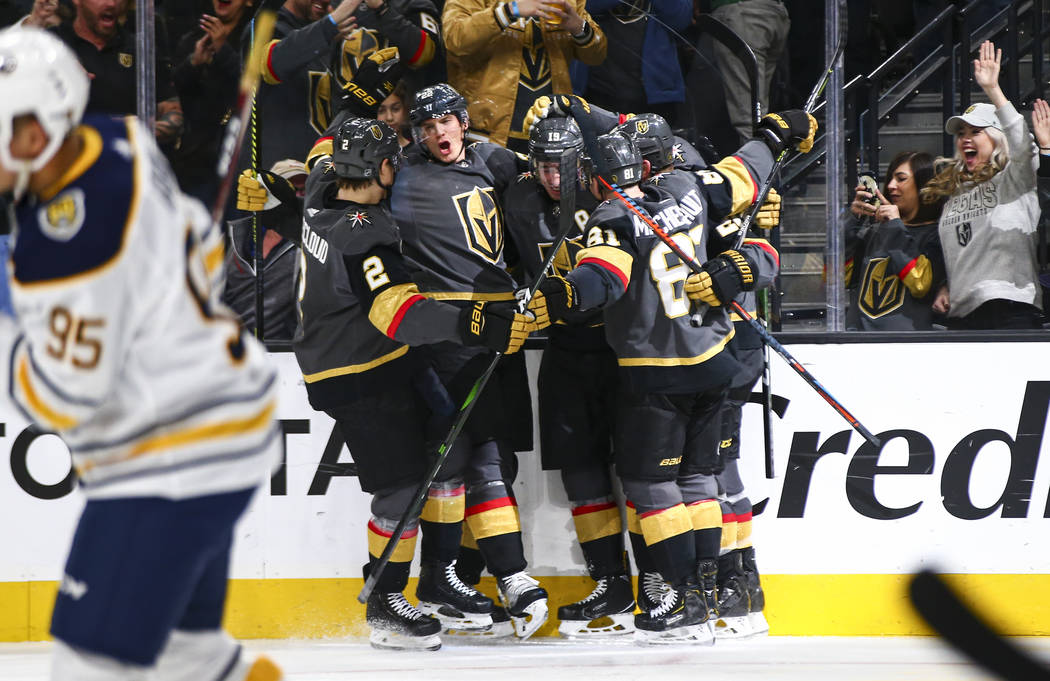 Golden Knights players celebrate a goal by Reilly Smith during the third period of an NHL hocke ...
