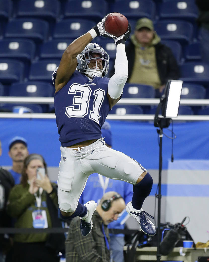 Dallas Cowboys cornerback Byron Jones catches during pregame of an NFL football game against th ...