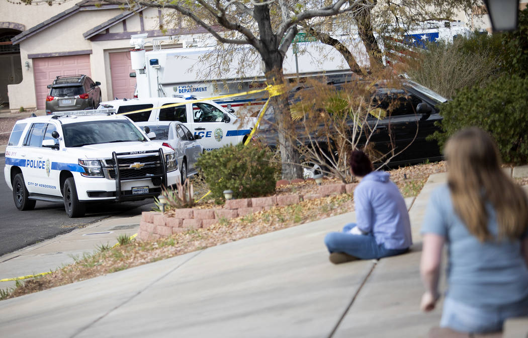 "Neighbors watch officers work an ""officer-involved"" shooting occurred near Cabana Bla ..."