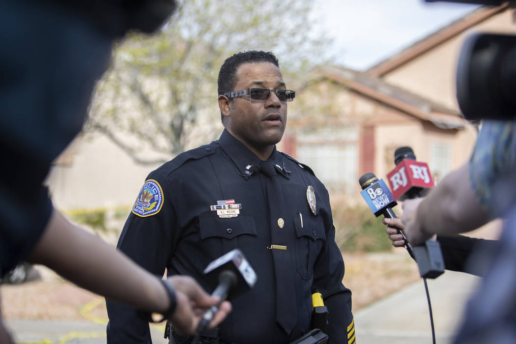 "Officer K.L. Moore gives a media briefing about an ""officer-involved"" shooting that o ..."