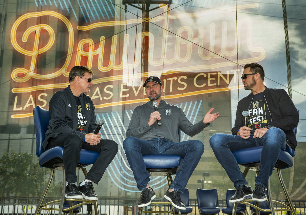 Head coach Peter DeBoer, center, is interviewed by Vegas Golden Knights' sportscasters Dave Gou ...