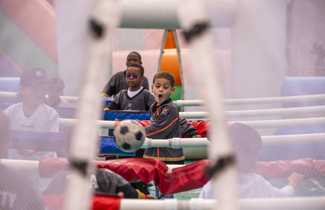 Maddox Bryan, 6, reacts to a kicked ball during an inflatable soccer game during the Vegas Gold ...