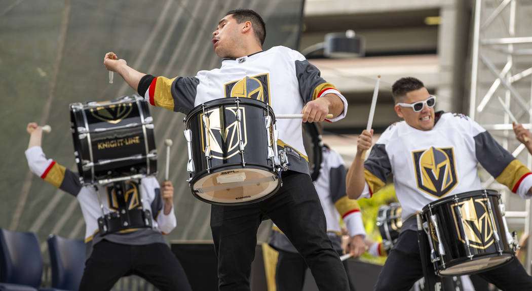 The Knight Line perform for the crowd during the Vegas Golden Knights Fan Fest at the Downtown ...