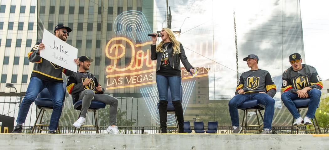 Vegas Golden Knights rinkside reporter/host Stormy Buonantony, center, moderates as players enj ...