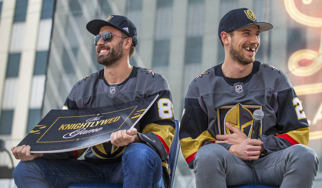 Vegas Golden Knights players Alex Tuch, left, and Shea Theodore laugh as they play a round of T ...