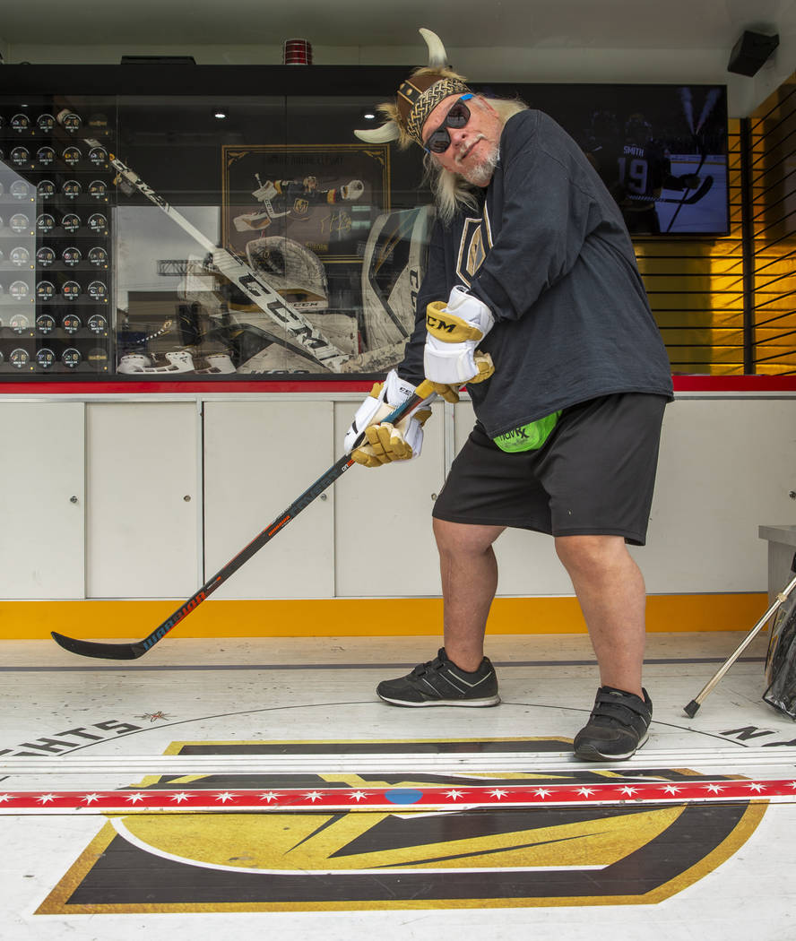 Super fan Robert Gray poses as a hockey player during the Vegas Golden Knights Fan Fest at the ...
