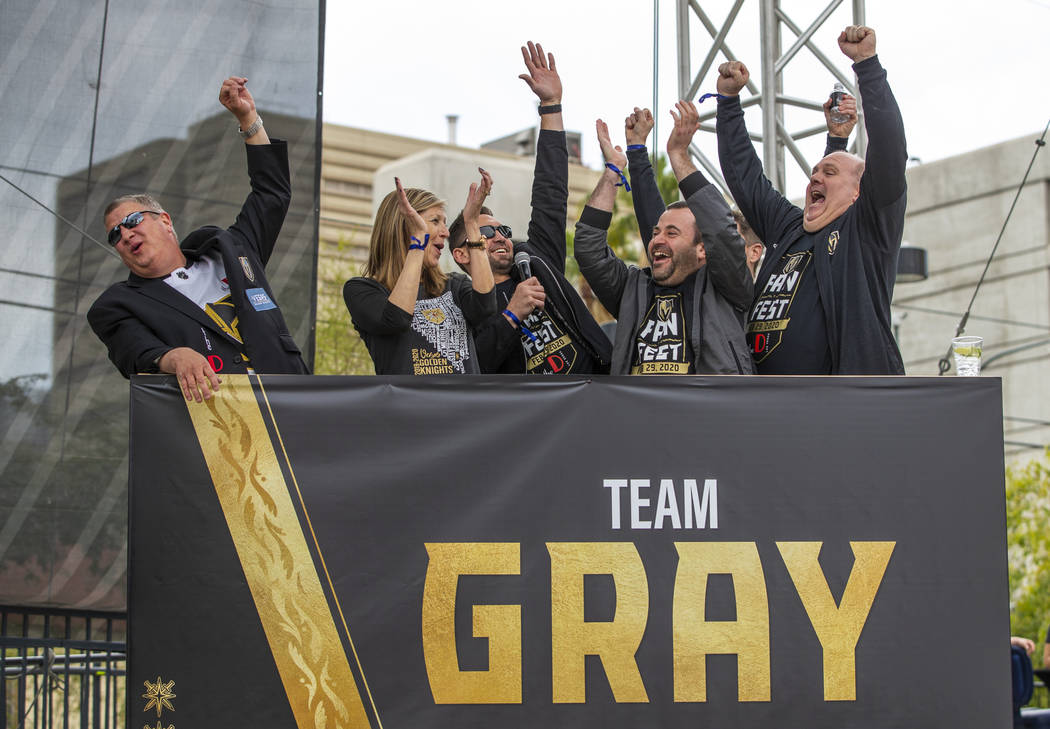 Team Gray celebrates their first round win during a game of Knight Family Feud on stage during ...