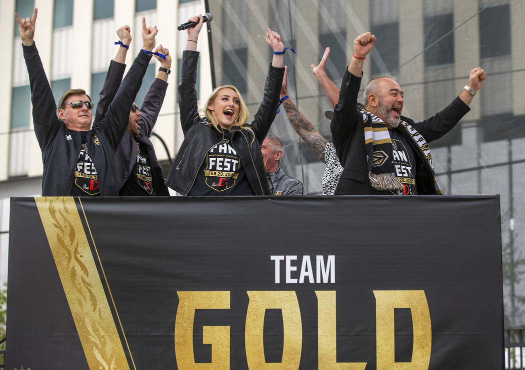 Team Gold celebrates their second round win during a game of Knight Family Feud on stage during ...