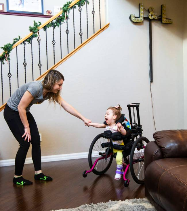 "Ariana uses an adaptive ""stander"" that helps her bear weight on her legs. (Chase Stevens)"