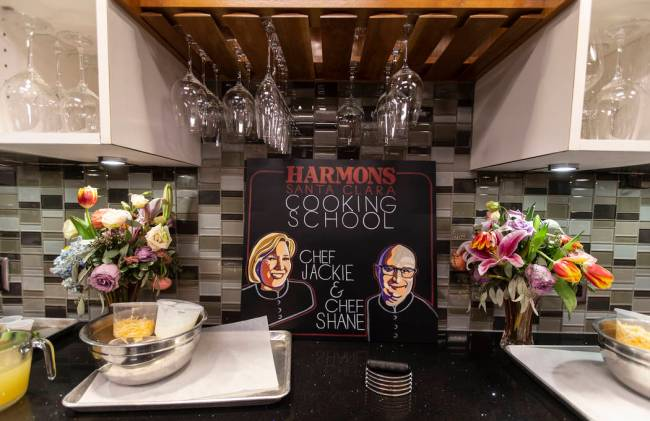 A sign bearing portraits of Harmons Cooking School chefs Jackie Dodart and Shane Robillard was ...