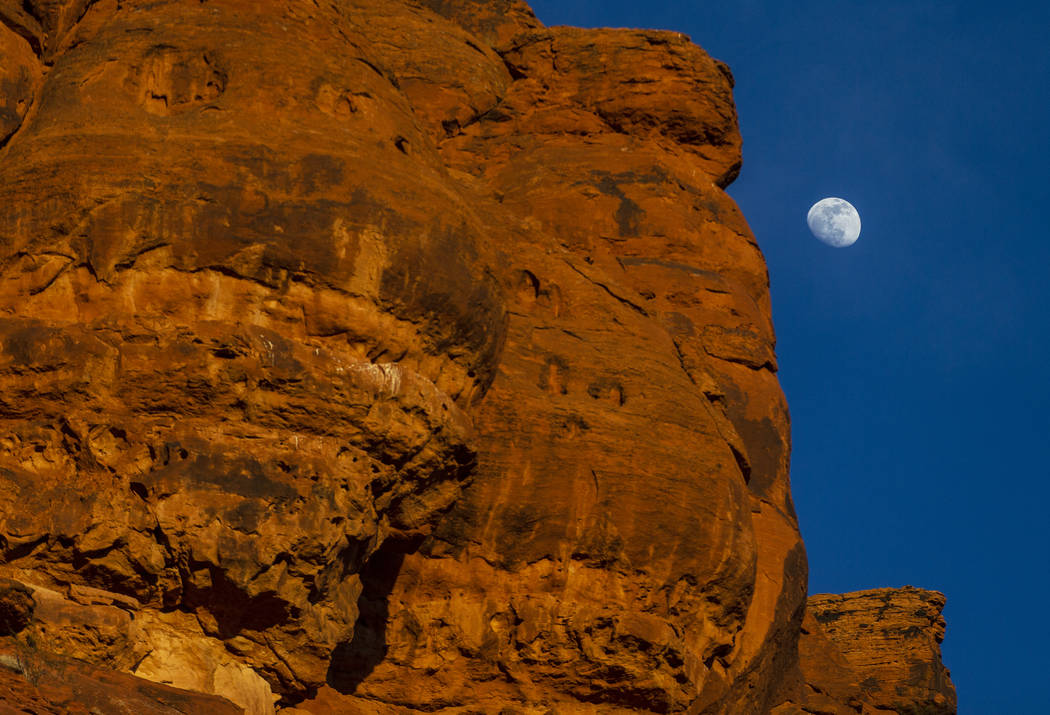 The moon rises over the mountains in St. George, Utah on Wednesday, Jan. 5, 2020. (Benjamin Hag ...