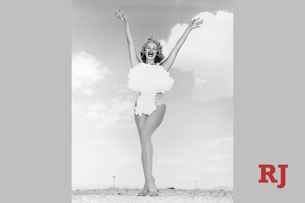 Lee Merlin, the last woman crowned Miss Atomic Bomb on May 24, 1957, sports a mushroom cloud ba ...